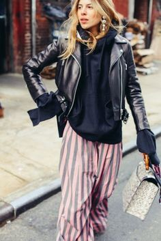 Street Style, Maja Wyh in striped wide leg pants and black leather motorcycle jacket, gray and blush pink wide leg pants, black sweatshirt and black leather moto jacket look, edgy casual street style,