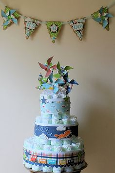 baby boy party decorations.  LOVE LOVE LOVE the multilayer dipper cake idea.  I have seen this at other showers and it is always a big hit. SOOOO COOL! THe top could be much nicer then this picture though.
