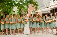 Love the contrasting flowers with the seafoam dresses