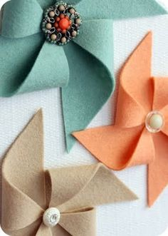 "Felt pinwheels. Love the vintage button! These are so cute secured to a homemade card.  Just add a stem and you have a darling ""flower."""