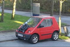 """This little industrially designed Kewet car is named """"Stadt-flietzer"""" in Germany - city-zipper - makes a U-turn on any narrow street and parks where other can't. Great fun - handles like a bumper car! :)"""