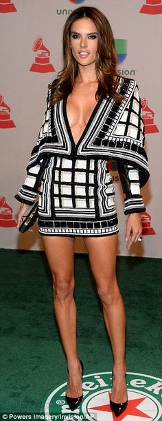 Revealing: Alessandra Ambrosio, left, wore a Balmain mini dress to the 2014 Latin Grammy Awards at the MGM Grand Garden Arena in Las Vegas, on Thursday before swapping to a sizzling white gown