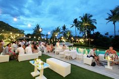 Exactly what the reception should look like - bench style seating, hanging lanterns, tealights around the pool and fairy light in the trees
