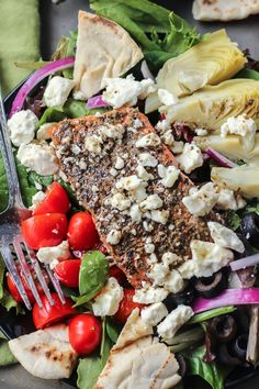 A Greek Salmon Salad ready in 10 minutes. Prep the veggies while the salmon cooks and you'll have this delicious meal ready in no time. Paleo-friendly.