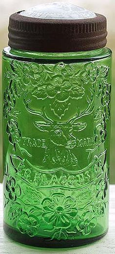 EC FLACCUS pint jar in bright emerald green with Stag's head design and original closure