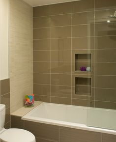 I like the kids bathroom with an accent wall (different tiles) and the tiles wrapped around the bathtub.