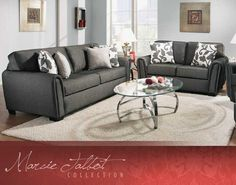 Love the dark grey couch, not terribly excited about the pillows. Pillow fabric is on the coordinating occasional chair.