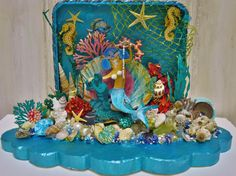 """""""Under The Sea"""" Mixed media piece featuring #DecoArt products and natural seashells -see more at my blog"""