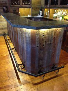 Custom reclaimed wood bar, Stone, wrought iron & lighting. Vintage barn siding wood hand picked. LED lighting & wrought iron foot rail