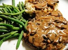 Slow Cooker Cube Steak and Gravy - Super easy but I changed it up a bit because I get home too late to fuss around. I just added 2 cups of beef broth, 1 can of golden mushroom soup and 1 can of cream of mushroom soup and an envelope of mushroom gravy mix. Sprinkle in some Garlic Garlic and presto! Gravy is ready all at once. So good and easy. Whipped up some reds and this was a very easy