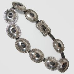 """#adobegallery - Cochiti Pueblo Sterling Silver Concha Belt. Silviano Quintana (1915-2003)      Category: Belts and Buckles     Origin: Cochiti Pueblo     Medium: sterling silver, leather     Size: 30"""" to 33"""" waist size;     3"""" x 2-1/2"""" concha size;     3"""" x 2-1/8"""" buckle     Item # C3276"""