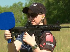 On Shooting USA's Impossible Shots, Julie Golob shoots over her shoulder with an M&P 15-22 as her take on the Annie Oakley exhibition shot.