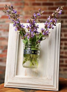 Framed Mason Jar Wall Sconce Rustic White Flower/ Plant/ Candle Holder, via Etsy.