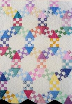 Nine patch set with triangles and sextagon blocks for wedding ring effect.