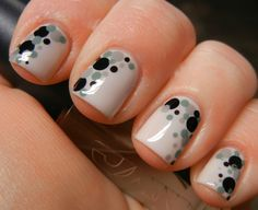 The Dappled Dot Manicure has a cool retro vibe that's at once sophisticated and playful.