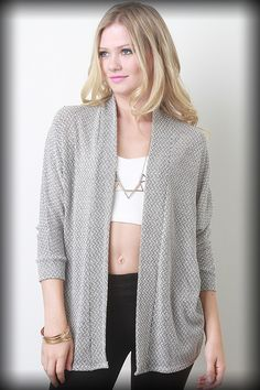 MAIN KNIT CARDIGAN Featuring a woven knit main, 3/4 length sleeves, and open front. Accessories sold separately. Made in U.S.A. 60% Polyester, 36% Cotton, 4% Spandex.