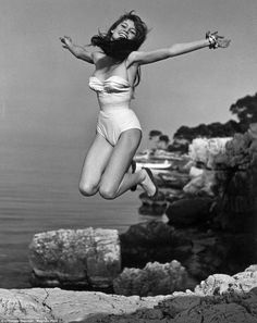 A swimsuit-clad Brigitte Bardot, who throws her arms out into the air as she leaps atop a cliff, can be seen in the Jump Book