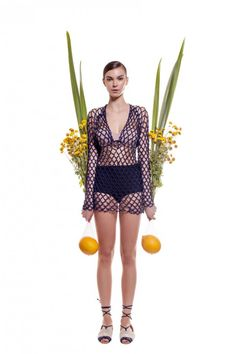 Check out fashion designer Helen Rodel's crochet love knot mesh coverup for Summer 2015.
