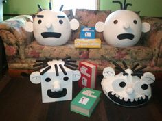 Diary of a wimpy kid masks. Paper mache, box, pool noodles for hair n fabric mouths