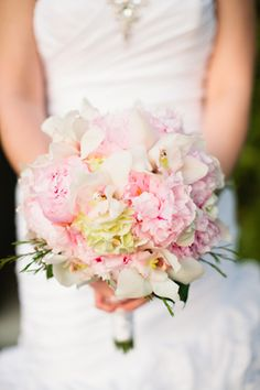 Pink bouquet of peonies, orchids, roses and hydrangeas.