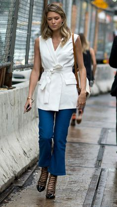 Street Syle: 70 MAJOR Outfit Ideas to Steal from New York Fashion Week Fall 2015 - Sleeveless white vest + matching obi belt, cropped denim flares, and cutout ankle boots