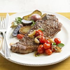 Pan-Fried Garlic Steak and Potatoes Topped with fresh oregano and tomatoes from the garden, this 30-minute steak dinner is fast even for a last-minute get-together.