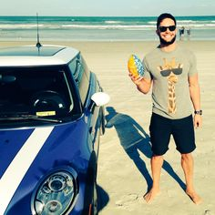Finn Bálor and a Mini Cooper... yes.
