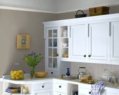 wall color with natural or white cabinets.   use black knobs..