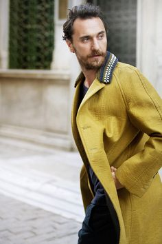 Yellow Rubbarized Silk Coat with Knit Collar, Firat photographed by Umit Savaci in Istanbul. Men's Fall Winter Street Style Fashion.