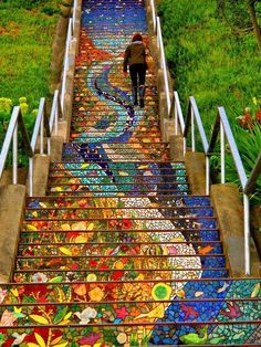 """San Francisco's Secret Mosaic Staircase. Over 2,000 handmade tiles and 75,000 fragments of tile, mirror and stained glass has gone into the finished piece. There are a total of 163 separate mosaic panels created, one for each step riser.  """"The steps paint a picture of the sea flowing into the sky. A colorful twist of water and sea life swirl up the steps to land with flowers, plants, birds, and frogs and ends with a beautiful sky with stars and even a massive sun."""""""