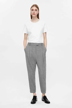 These tailored trousers are made from a soft wool-blend with pleats and a tapered leg for a loose, rounded shape. Designed to sit on the waist and dropped at the crotch, they have back and front pockets, turn-up hems and a classic zip fly fastening.