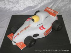 Boys formula one racing car cake finished with edible Vodafone logos http://www.cakescrazy.co.uk/details/racing-car-cake.html