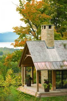 like the variety in the roof & huge overhangs....not to mention, the chimney...