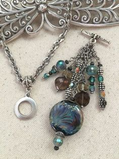 Swirls of Color Beaded Chain Necklace. Interchangeable Handmade Beaded Pendants attach effortlessly to chain of your choice. Great gift idea. Visit website to see entire collection. Chains and Pendants are sold separately. Start your collection today.
