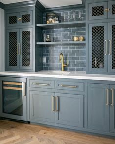 Gorgeous blue grey painted custom wet bar with subway tile and decorative inset grills in cabinet doors. Wet Bar Cabinets, Blue Gray Kitchen Cabinets, Green Cabinets, Kitchen Cabinet Colors, Painting Kitchen Cabinets, Kitchen Paint, Dark Cabinets, Blue Kitchen Ideas, Painted Gray Cabinets