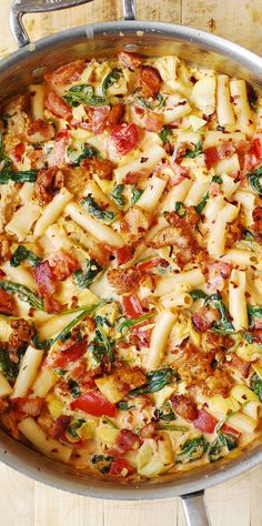 Spinach and Artichoke Chicken Pasta with Bacon and Tomatoes in Asiago Cream Sauce - yummy pasta with lots of veggies! The vegetables are smothered in such a delicious Asiago cream sauce (and crumbled bacon) that even non-veggie lovers will love this dish. Chicken and Pasta lovers will certainly love this dish!