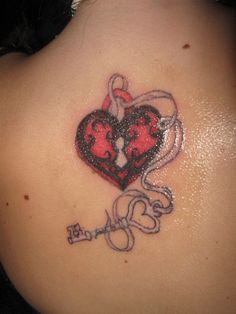 A really pretty in pink lock and key tattoo design. The lock is in red and black heart shaped design with a pink ribbon looping outwards from the top part. The pink ribbon then loops itself with the key which also has a heart shape carved in it.