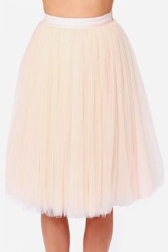 """As Seen On Christine of Hello Fashion blog! Raise a glass to the All in Good Cheer Peach Tulle Skirt, and how good it'll look with some swanky new heels! Several layers of peach-colored tulle gather at the fitted waistline of this captivating skirt, and drift down creating a cute layered look. Tulle is backed by a breathable layer of chiffon above a blush satin lining. Hidden side zipper/clasp closure. Fully lined. Model is 5'8"""" and is wearing a size small. Self: 100% Nylon. Contrast: 100%…"""