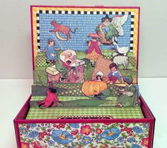 http://craftknifechronicles.blogspot.com/2014/06/mother-goose-pop-up-box-and-mini-book.html