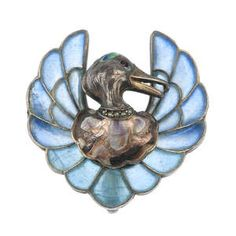 Meyle and Mayer. An early 20th century silver plique-a-jour brooch, designed as a multi-shade enamel mallard's head with pink paste eyes and seed pearl collar, to the blue plique-a-jour enamel wings. With maker's mark. Length 3.2 cms.