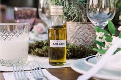 Small bottles of olive oil for the guests favours  at winery wedding in Crete | Crete for Love
