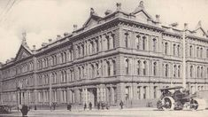 Former Victorian Railways offices, Spencer St #Melbourne - built 1893, seen here c.1900. The fourth floor was added in 1912, which saw the removal of most of the pediments, finials and statuary as depicted here, and adding paired Edwardian domes above the entrance. A further attic floor was added in 1922. Converted to apartments, 1998. Protected.