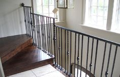 A custom forged and rusted metal railing for a 1930′s home in Winnetka.