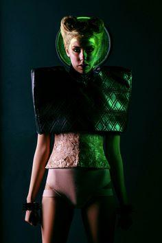 Dramatic green colour gel  photoshoot. Photographer David Long exposure studios London. Model Nicola. MUA Amy Prifti. Designer Isaac Raymond.