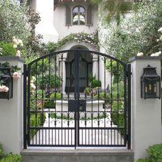 Pretty iron gate opens to courtyard