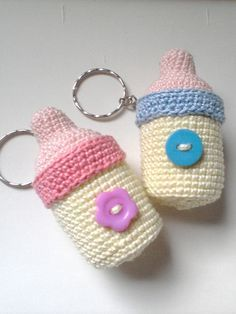 Crochet Feeding Bottle Keychain (original design)  This is my best selling pattern on ravelry. It's easy to make and are cute keepsakes for Baptisms or Baby Showers.  find the pattern here: http://www.ravelry.com/patterns/library/baby-shower-souvenirs-bundle
