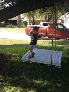 A pallet and some rope makes a multi-person swing. | 51 Budget Backyard DIYs That Are Borderline Genius