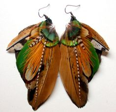 http://www.etsy.com/listing/88606990/something-wild-feather-earrings-free
