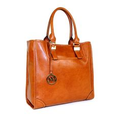 A tote that's resourceful as it's fashionable. The well-traveled and cultured woman will want this.