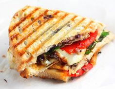 chicken panini with roasted bell peppers, and caramelized onions